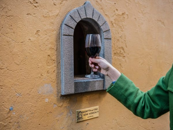 Centuries-old wine windows in Florence put a novel spin on physical distancing CBCnews